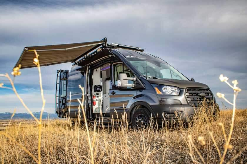 A Pikes Peak Antero Adventure Van with all the doors open