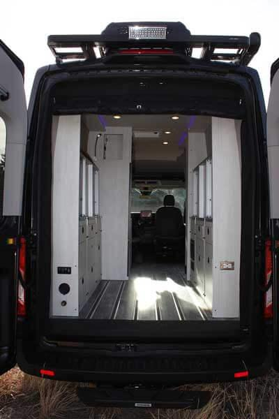 The back of a Pikes Peak Antero Adventure Van with the doors open